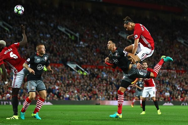 MANCHESTER, ENGLAND - AUGUST 19:  Zlatan Ibrahimovic of Manchester United scores the opening goal with a header during the Premier League match between Manchester United and Southampton at Old Trafford on August 19, 2016 in Manchester, England.  (Photo by Michael Steele/Getty Images)